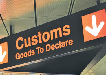 Customs sign at airport