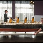 Members of the Alban Shipping team move the model of the Mauretania