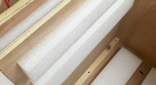 Interior of wooden packing case with foam battens